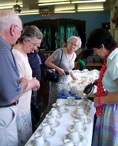 Megan Fitzgerald-Plummer is pouring tea and with her are the sisters, Mary King and Sheila Skitt.